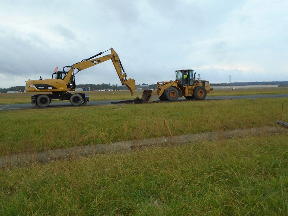 Removing pavement for the north taxiway connector.